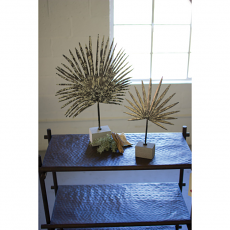 Two Metal Palm Leaves With Concrete Bases